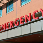 image of red letters spelling 'emergency' above a hospital entrance